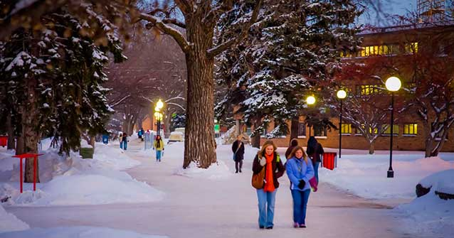 Students walking on the MSUM campus in winter