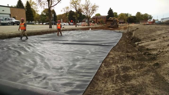 Laying Fabric for Roadway Preparation